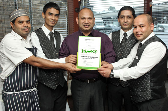 Matin Khan with Itihaas staff displaying TripAdvisor Certificate of Excellence